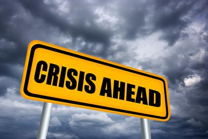 Crisis ahead road sign